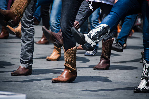 slim fit jeans with cowboy boots